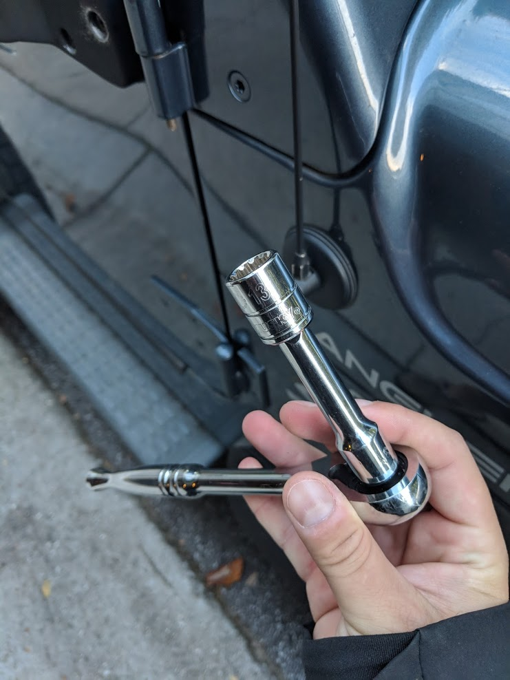 Be sure to use a six-point 13mm socket when removing the Jeep door nuts.