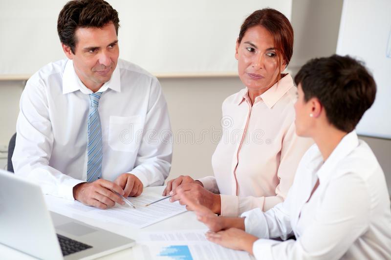 latin-executive-team-working-documents-portrait-sitting-office-desk-35776517.jpg