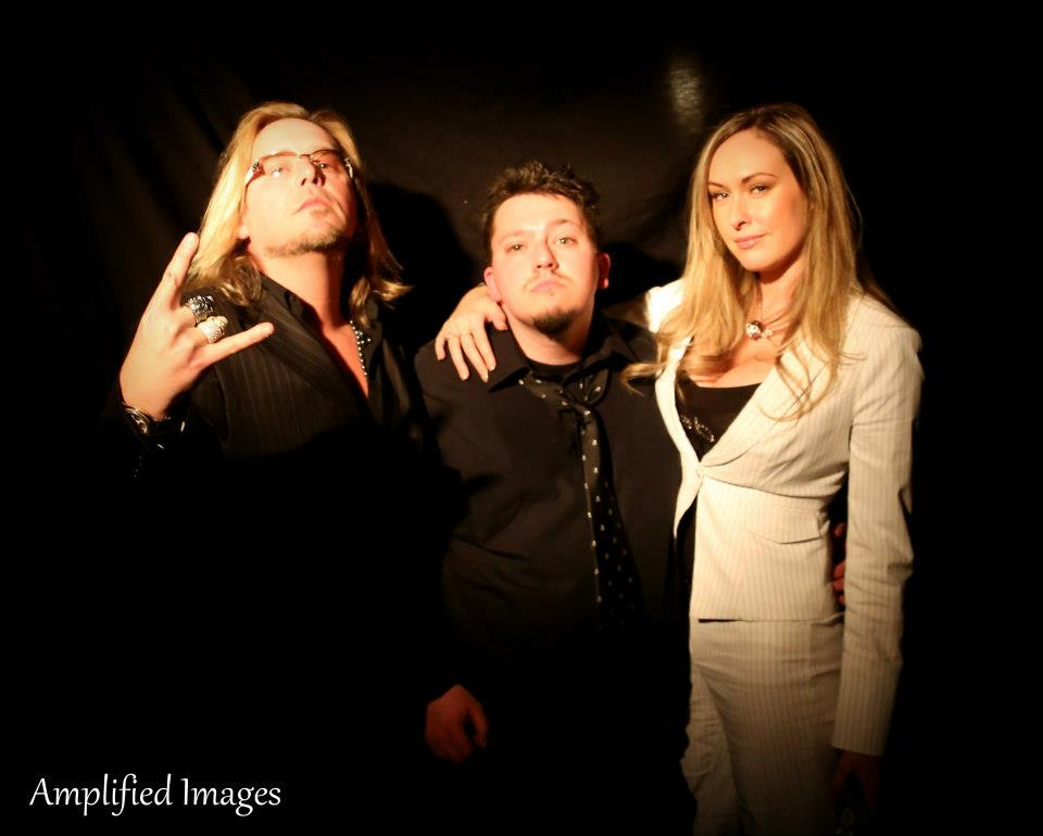 Photographer Scott Church, Show Creator Nick Meyers & Playboy Model pose for a photo after presenting an awards.  Photo Credit: Amplified Images