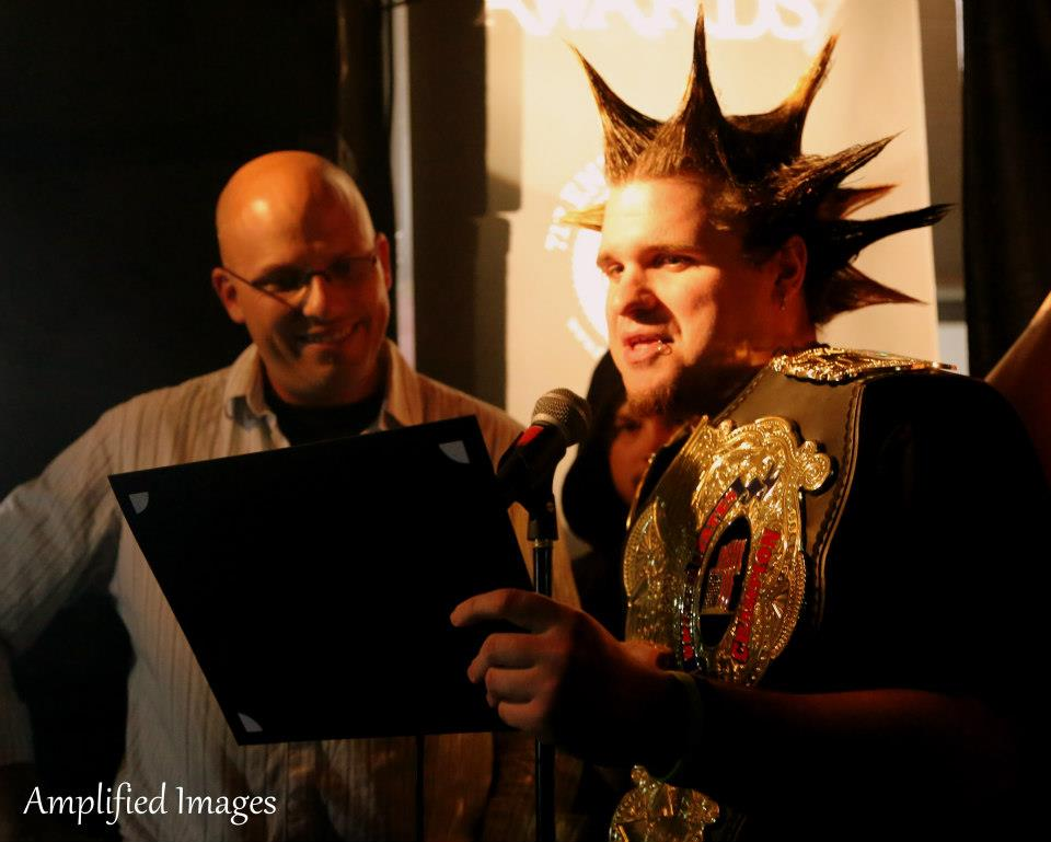 Rob Simon of 105.7 The X and Justin Mack of the UWE present an award.  *Photo Credit: Amplified Images