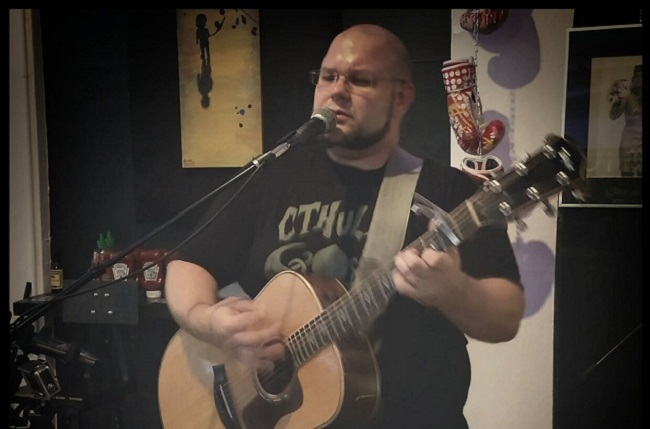 Ben Bollinger of Six Bar Break performs on the Acoustic Stage