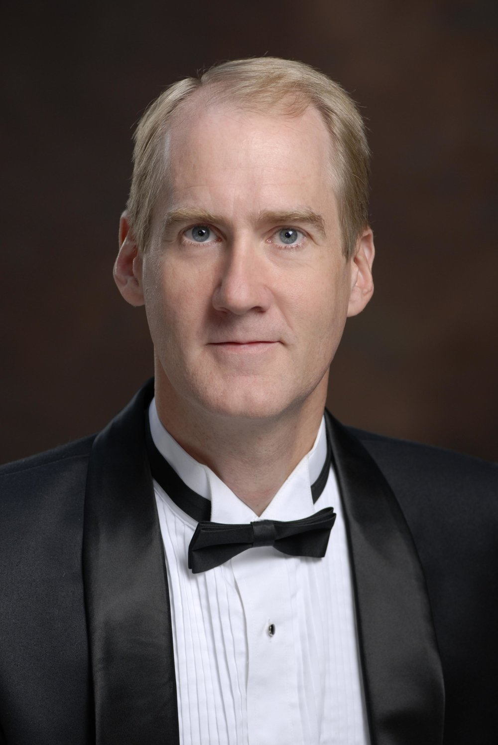 """Peter van de Graaff, narrator - A native of the Chicago area, Peter van de Graaff began his radio career at KBYU in Provo, Utah in 1984 and went to WFMT in Chicago in 1988. In 1989 he began hosting a nationally-syndicated program called the """"Beethoven Network"""", carried on 150 stations throughout the country.In September 2010, Peter van de Graaff was awarded the sixth """"Karl Haas Award for Musical Education"""" from Public Radio International, joining other winners Leonard Slatkin, Michael Tilson Thomas, Peter Schickele, Bill McGlaughlin and Martin Bookspan. Peter now is the music director of KWAX.He has hosted two nationally-syndicated opera series on National Public Radio and has been heard on many other national broadcasts such as the Vienna Philharmonic, the Van Cliburn Competition, Music of the Baroque and others. He was one of the finalists for host of the Metropolitan Opera radio broadcasts."""