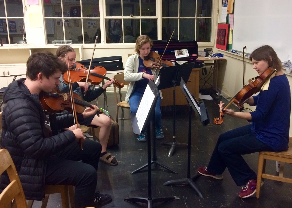 OMP violist Lauren Elledge works with violists from Eugene-Springfield Youth Orchestras