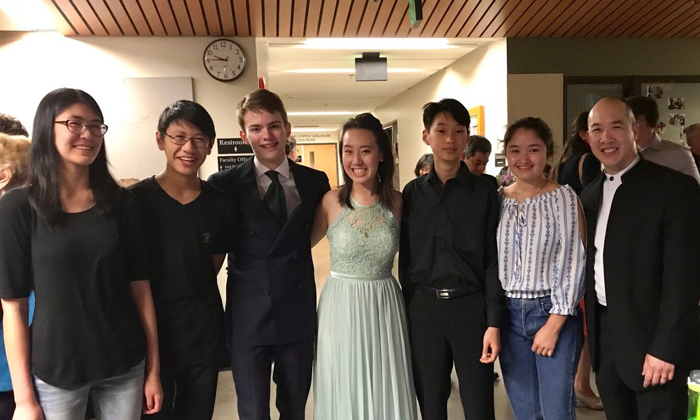 "Past OMP Young Soloist Competition Winners supporting the 2018 winners at our ""Joyful Finale"" concert! Avery Hsieh (Senior Division Winner 2017), Adrian Hsieh (Junior Division Winner 2016), Nicholas Dill (Senior Division Winner 2018), Annie Zhang (Senior Division, Second Place 2018), Ian Song (Junior Division Winner 2018), Grace Rosier (Senior Division Winner 2016) with Artistic Director Kelly Kuo."