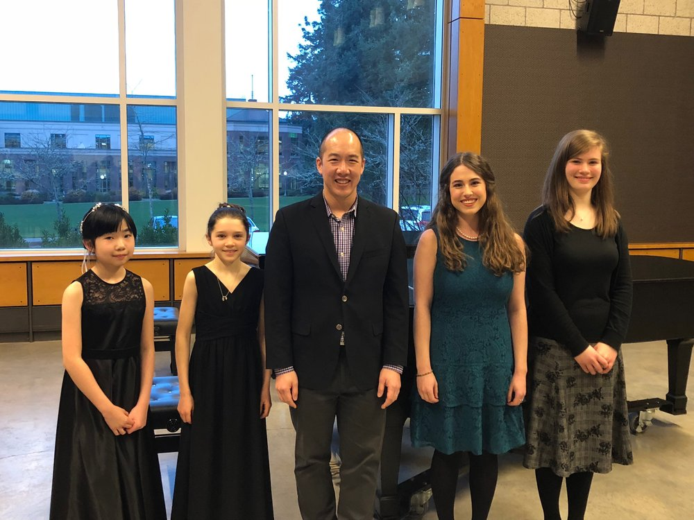 - From left to right with OMP Artistic Director Kelly Kuo: Sadie Wang (cello; 2nd-place Junior Division), Angela Rose Padula (cello; 1st-place Junior Division), Morgan Paige (soprano; 1st-place Senior Division), and Trinity Goff (piano; 2nd-place Senior Division).All four winners have been awarded cash prizes through the Trudy Rumple Prizes. Angela Rose and Morgan will be appearing as soloists with OMP on our concert.
