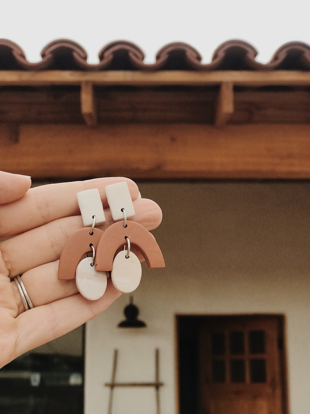 "These earrings are a nod to the ""blush"" floors and the arch and color of the terra cotta roof tiles."