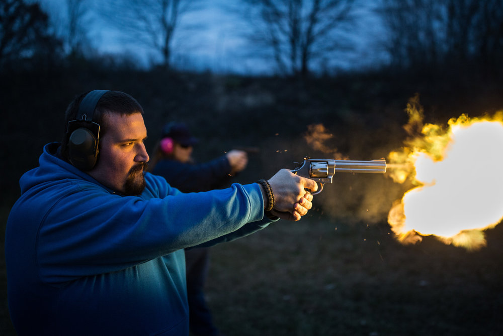 "Daniel Prewett, a member of the Black Creek Conservation Club, shoots pumpkins with his gun, ""Thumper,"" during the club's Fall Harvest Festival at the club's gun range in Mount Pleasant, Mich. on Sunday, Oct. 29, 2017. In August 2017, former members of the club filed a lawsuit against eight members, including Prewett, claiming that they were members of the Michigan Militia and had taken over the club."