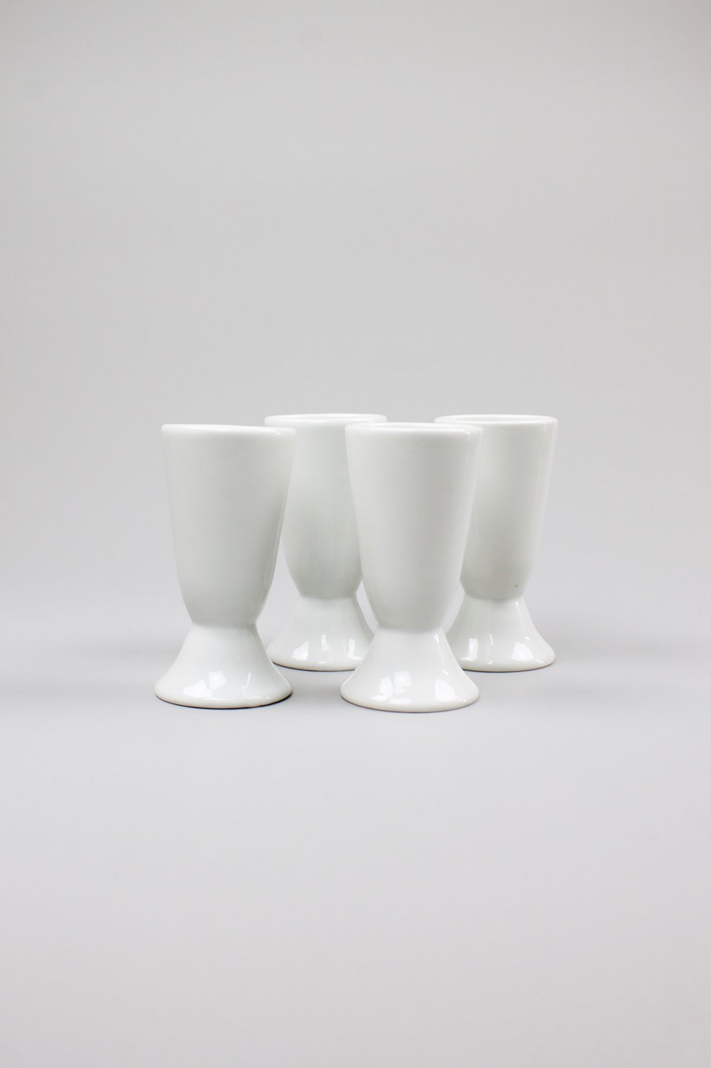 White ceramic cups   Set of four plain, oversized cups. These ceramic cone shapes could also be … lamp shades?