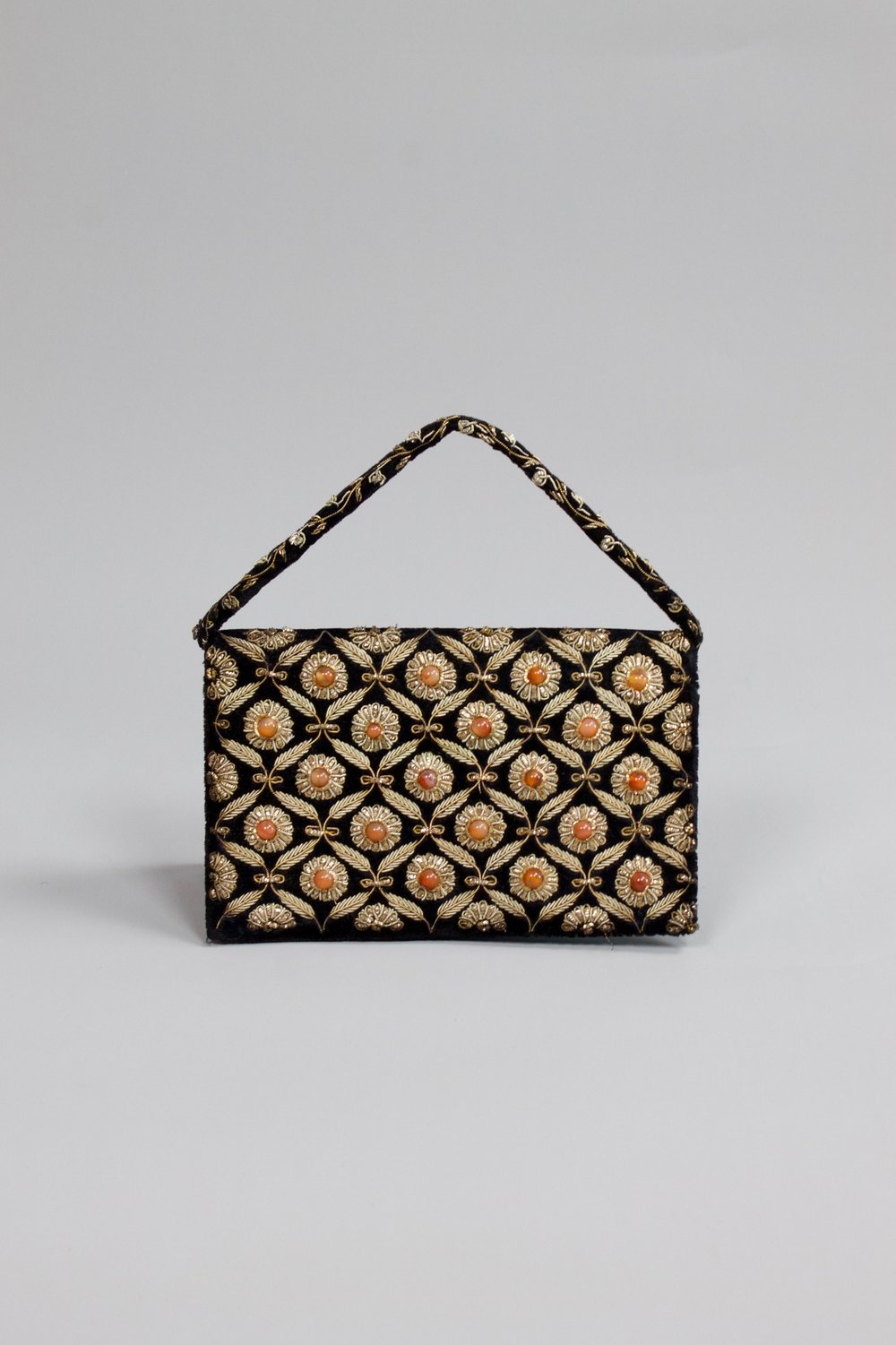 Gold embroidery purse   Found in a vintage shop in Paris. This bag is developed and manufactured in India.