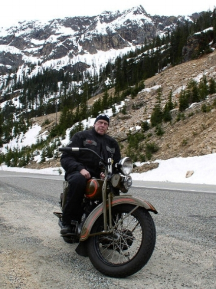 The Author Walt Greenwood astride his old iron in Washington Pass