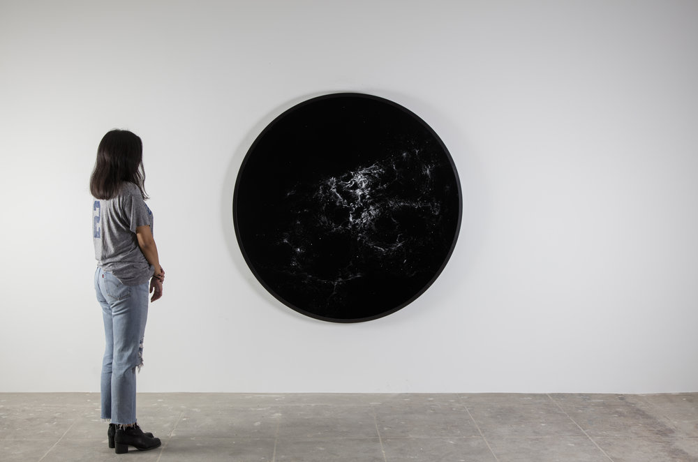 installation view of NGC 2070  2016  cocaine dust on photographer's velvet  60 1/8 inches diameter