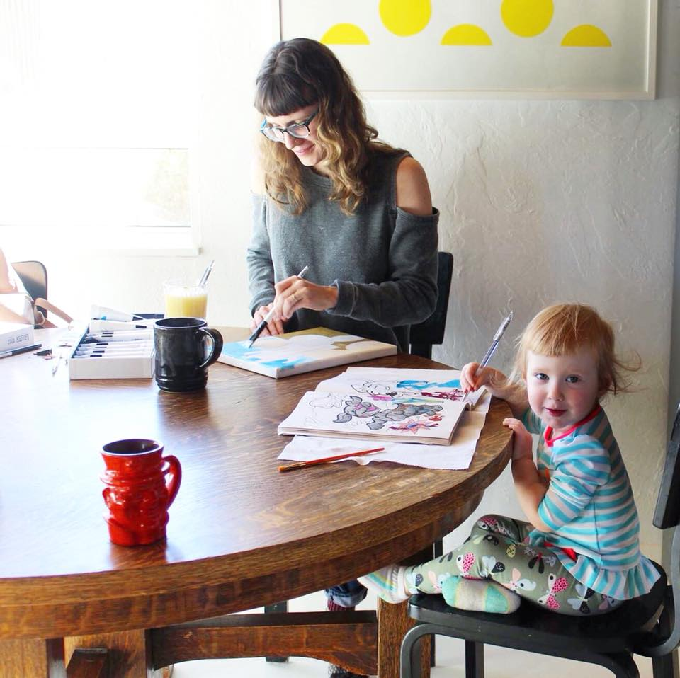 Erika Wynn painting with her daughter
