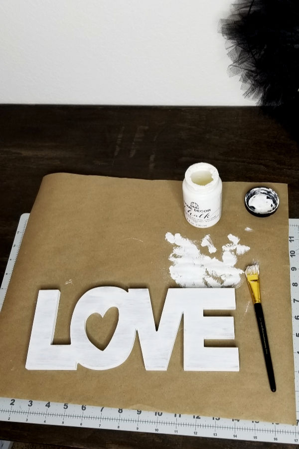3. Rustic Lovesign - *Use chalk paint and dry brush onto the wood love sign from Dollar Tree. If you can't find this there should be similar options at any craft store.