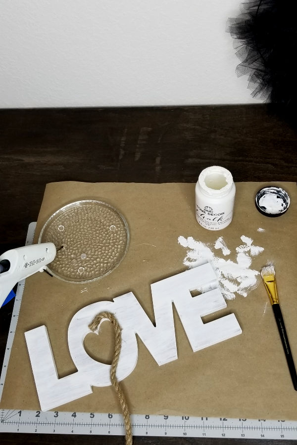 Add jute rope to the heart using hot glue -