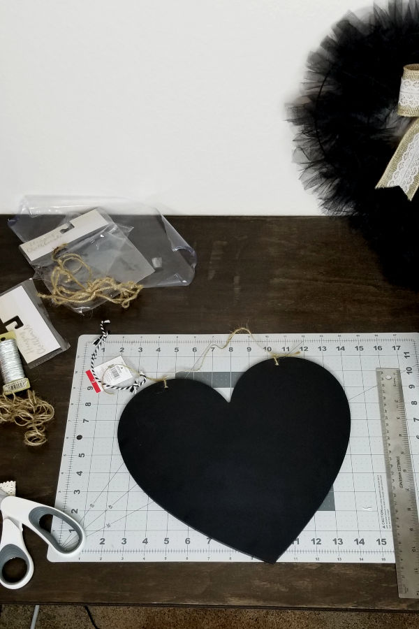 4. Chalkboard heart sign - *(Optional) change out the twine rope on this Target dollar spot chalkboard for a longer one*Add your phrase of choice using vinyl cutouts. I cut this using my cricut.