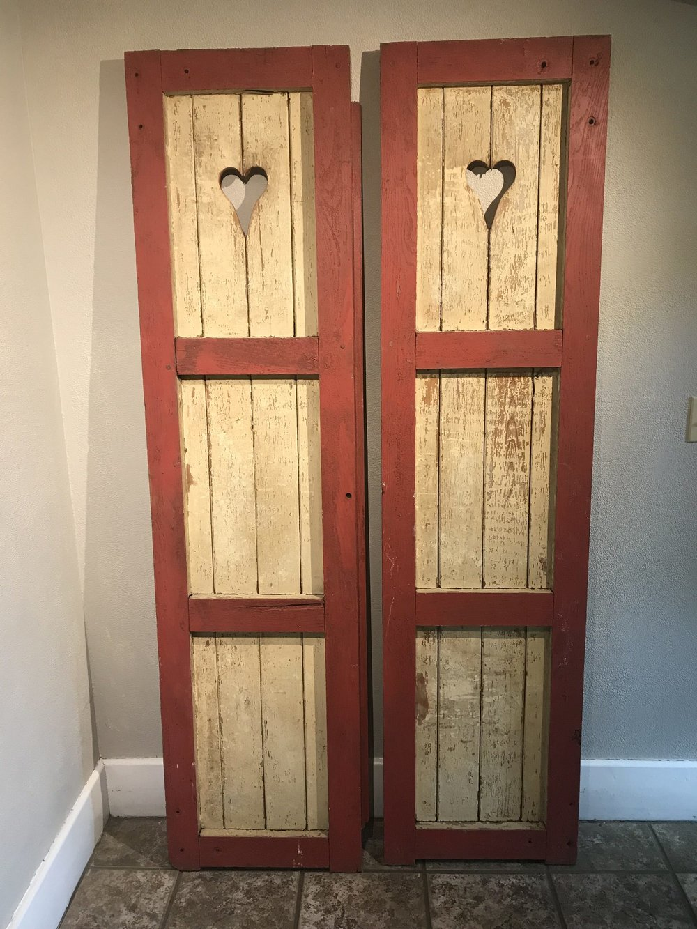 <p><strong>Wood & Red Heart Shutters</strong>$30</p>