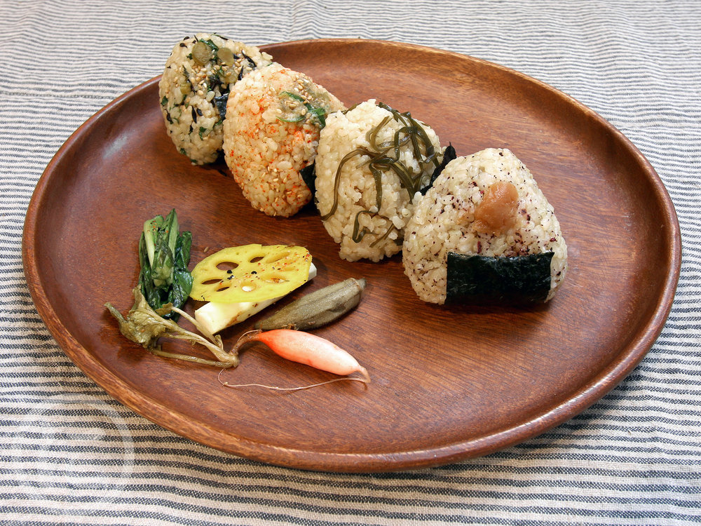 Onigiri Brown Rice Balls  Gluten-free. Available options (Vegan and Fish): - Ni's Signature Onigiri: Multigrains (barley), black sesame + Pickled plum - Kelp or Kale, white sesame - Jalapeno miso, white sesame - Spicy tuna or Salmon