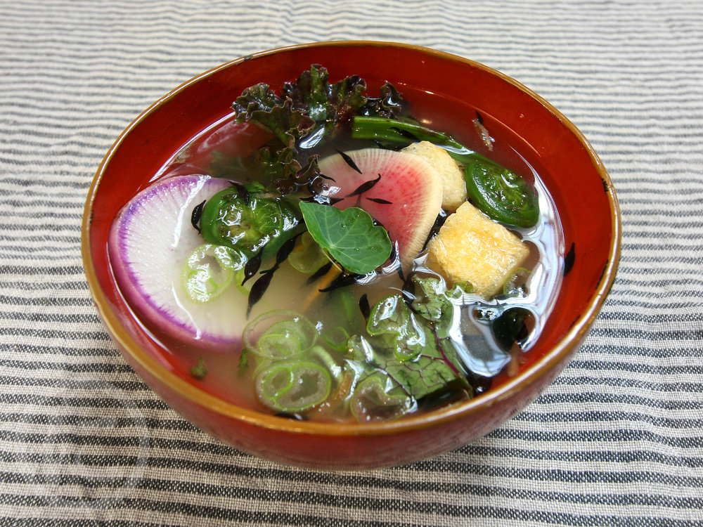 Miso Soup  Organic white miso, holy broth (vegan), seasonal vegetables. Nutritious, antioxidant and probiotic!