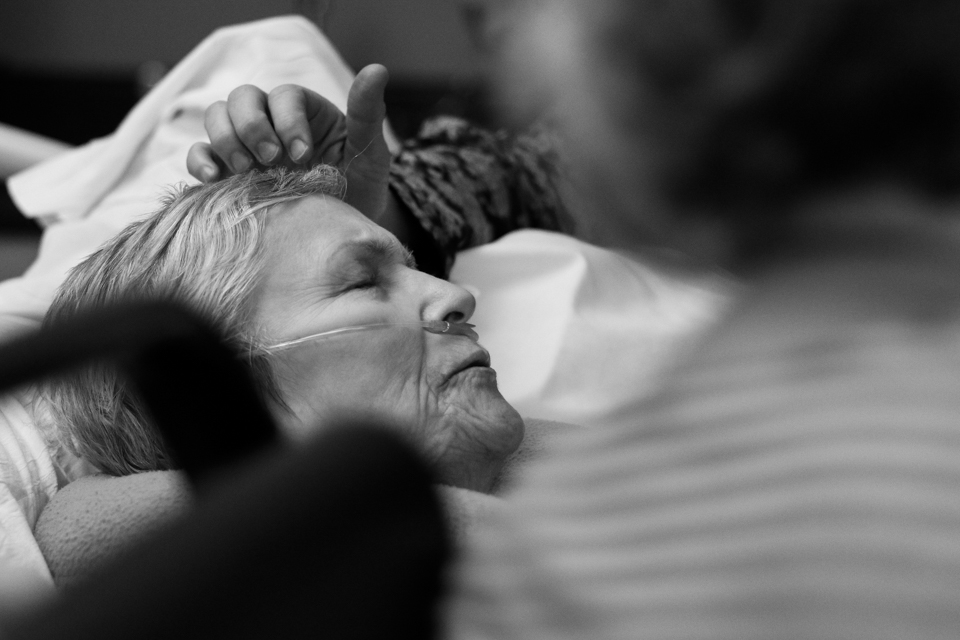 Leslie Hilderbrand strokes her mother Esther Cloud's forehead at at Wellstar Douglas Hospital in Douglasville, Georgia, on January 14, 2018.