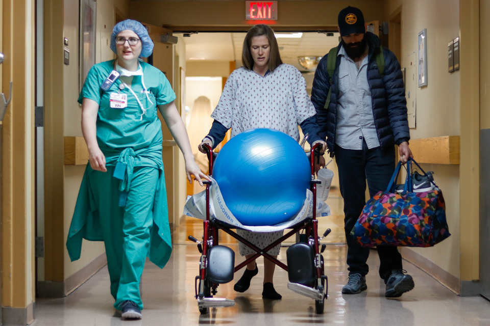 Melanie Zareie and husband, Cas, walk to their delivery room in Piedmont Athens Regional Hospital in Athens, Georgia, on April 9, 2018.