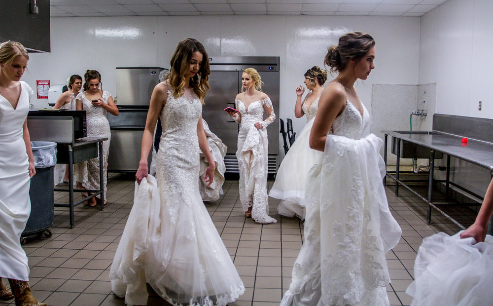 Models line up backstage in the kitchen of the Victoria Community Center before walking in the style show at the 2019 Bridal Showcase in Victoria, Texas, on Sunday, January 6, 2019.