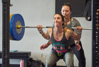 Bre getting up with a big squat, with a little moral support from Madeline.