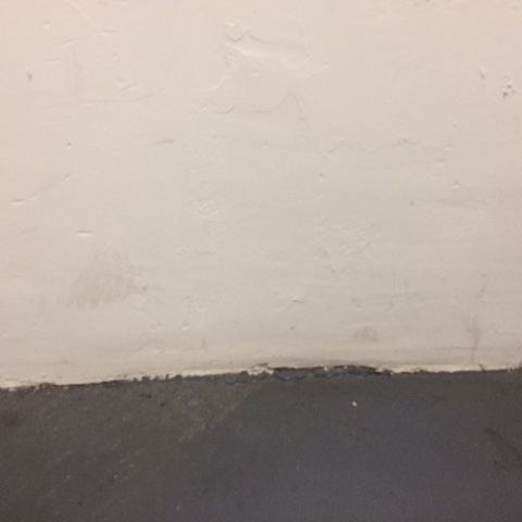 This wall, without a baseboard, speaks volumes about the value of even a most basic baseboard.