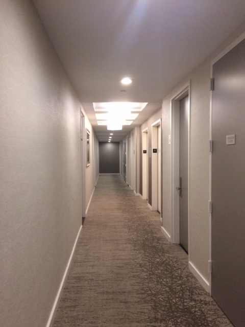 Notice how the baseboard brings a sense of structure and order to this hallway.