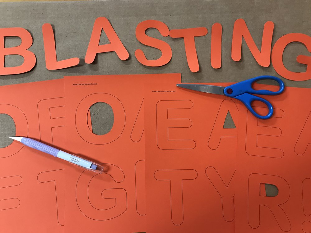STEP 3: Use scissors and an Exacto blade to carefully cutout the letters and shapes. It is important to cut them out before you laminate them.