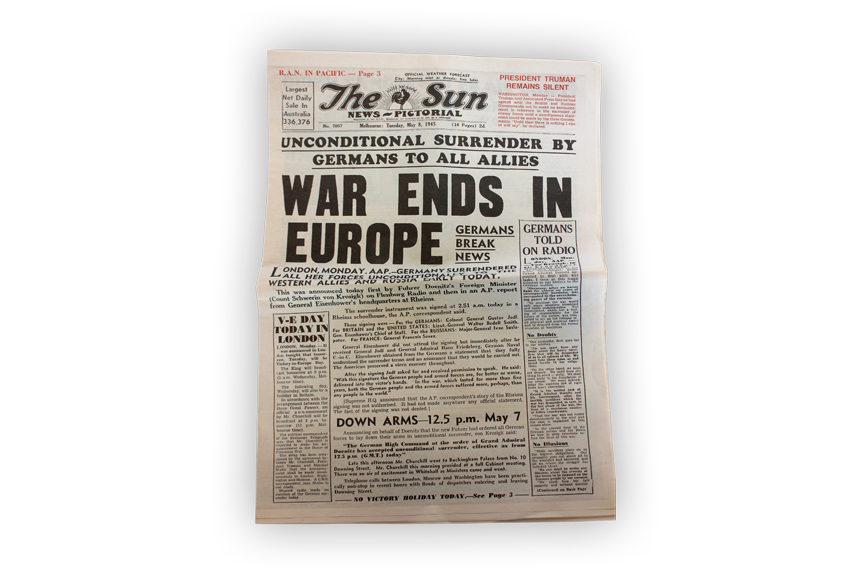 Image of newspaper published in 1945 declaring the end of war in Europe.