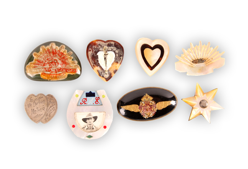 Image of a collection of sweetheart badges.