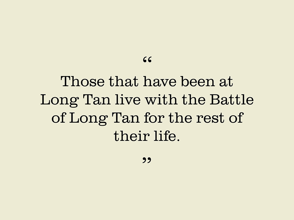 """Image showing a quote by Bill Akell. """"Those that have been at Long Tan live with the battle of Long Tan for the rest of their life."""""""