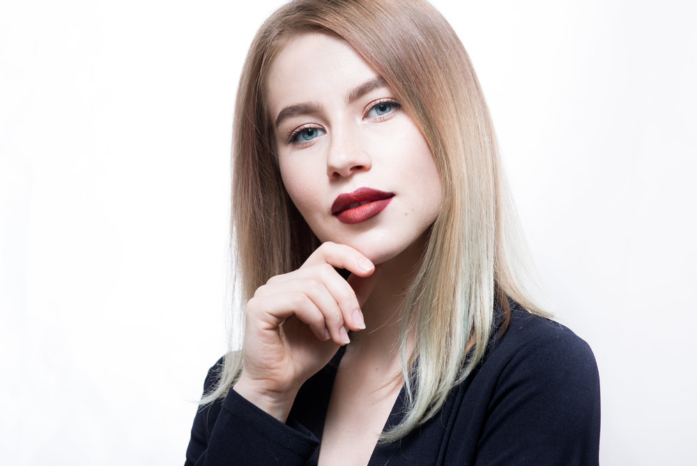 Professional business portrait of a young woman with red lips.jpg