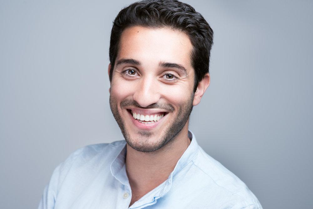 Professional business portrait of a smiling man expat entrepreneur in Prague