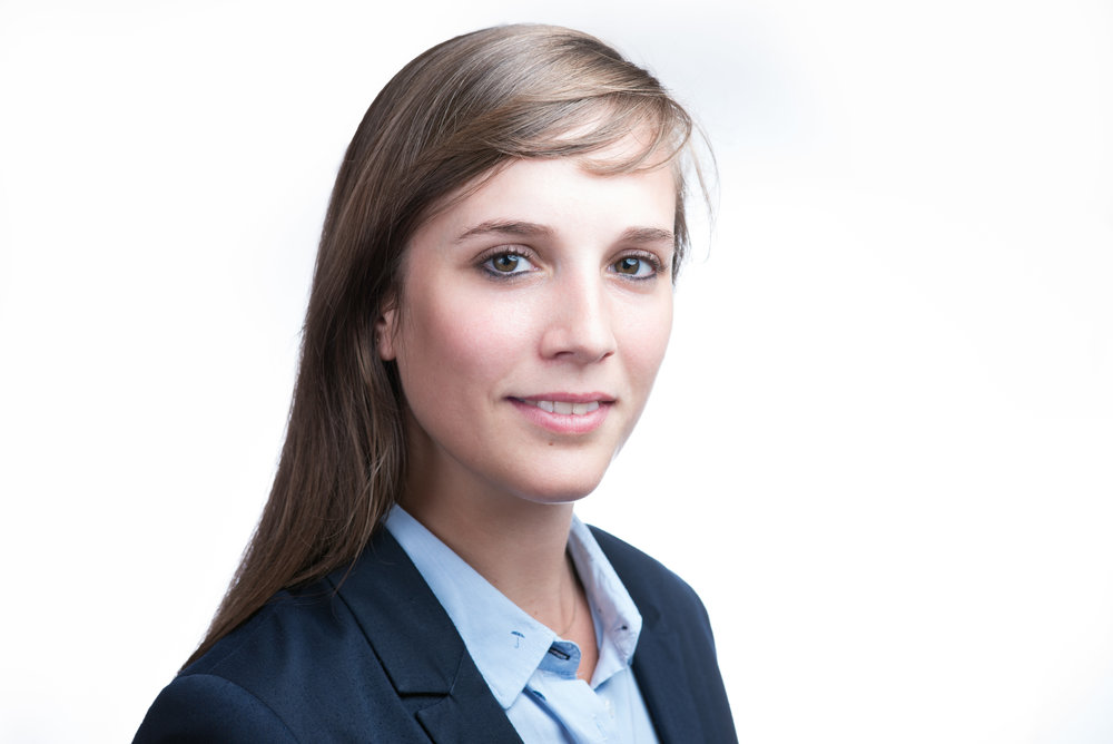 Professional business portrait of a young woman in a suit expat in Prague