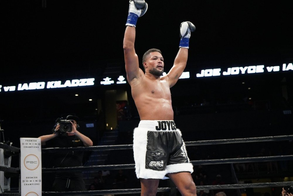 """By  Scott Gilfoid:  #10 WBA heavyweight contender Joe Joyce (6-0, 6 KOs) is really impressed with the sparring that he's done with former unified heavyweight champion Tyson Fury (27-0, 19 KOs) in Big Bear, California. Joyce is now trained by Abel Sanchez, the same trainer that former middleweight champion Gennady Golovkin is trained by. Joyce says that Fury, 30, is  """"the most talented I've been in the ring with,""""  according to Michael Benson.  Joyce, 33, is getting ready for a potential fight against former heavyweight world title challenger Gerald Washington (19-2-1, 12 KOs) in December. That's a big step up for the 6'6″ Joyce. Washington is just as big as Joyce, and he's been in the ring with Deontay Wilder, Jarrell 'Big Baby' Miller and Eddie Chambers.   """"Just need confirmation to get this party started,""""  Joe Joyce said to Behind the Gloves about a fight against Gerald Washington.  """"I'm looking forward to putting on another explosive performance. Gerald Washington is a solid opponent, and he's got a lot of boxing skills. He's a good step up for me, and I accept the challenge and get in the ring to put on another great display. I like his style. Here in the U.S, I've done some work with Bermane Stiverne and Dominic Breazeale,""""  Joyce said.  Washington, 36, is coming off of a nice 10 round unanimous decision win over John Wesley Nofire last June. In Washington's fight before that, he lost to Jarrell 'Big Baby' Miller by an 8th round stoppage in July 2017. Washington came close to knocking out the 298 lb Miller in the 5th round after hitting him with a flurry of shots. Miller was within an eyelash of being knocked out in the round, but somehow he weathered the storm and was able to survive. It appeared that Washington got tired of punching the defenseless Miller in the head with punches, and that's what saved 'Big Baby.' If Washington hadn't gassed out, he would have knocked him out. That performance showed that Washington is a threat to the top heavyweights. In Wa"""