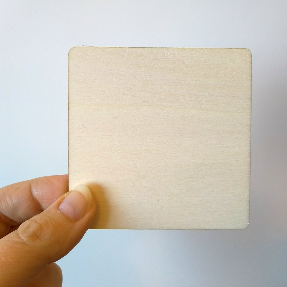 Wooden square tile