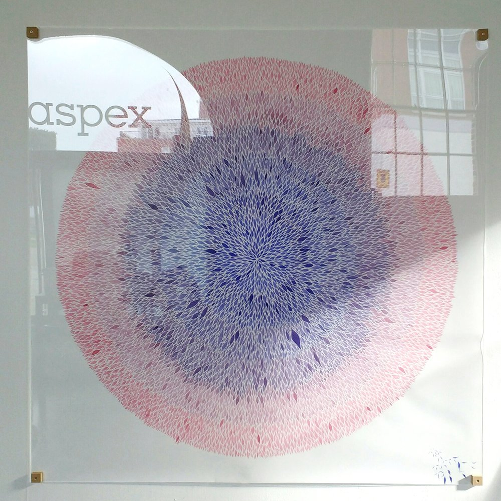 A 1.5 m sq circular ink pattern under perspex