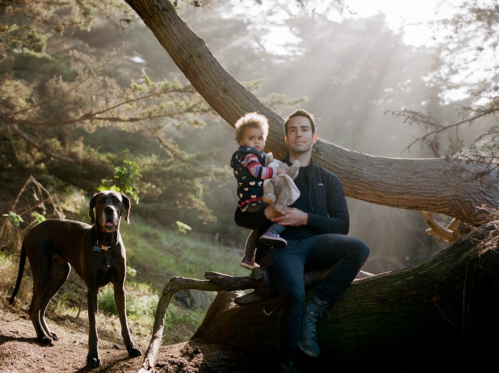 Family photograph with Great Dane on Land's End Trail in San Francisco, CA. by Rachel Sima Photography