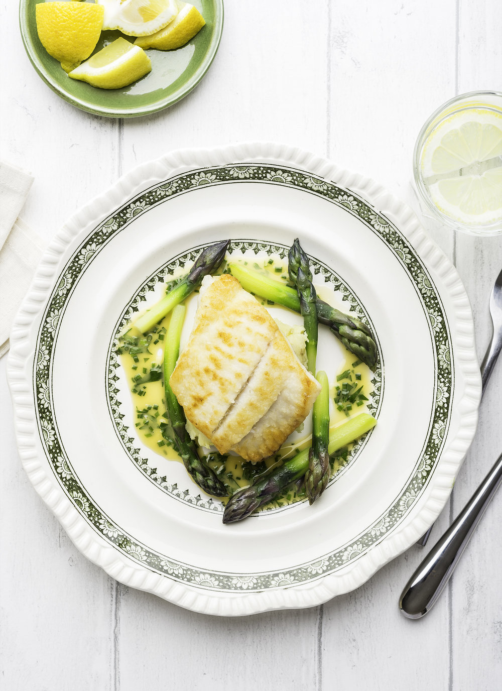 Fillet of brill with crushed Jersey Royals, asparagus & herb butter sauce - from Well Seasoned, exploring cooking & eating with the seasonsby Russell Brown & Jonathan Haley (Head of Zeus)