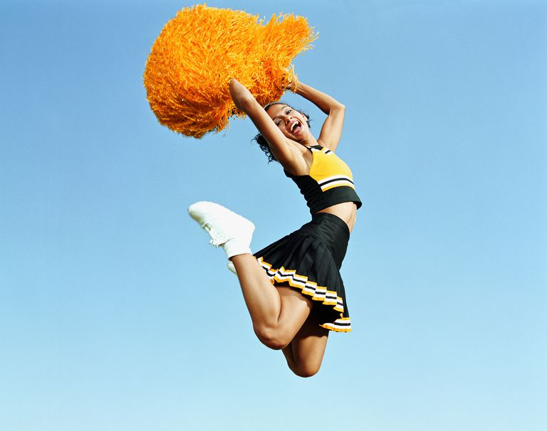 cheerleader-jumping-in-mid-air--holding-pompoms--portrait-200068151-001-59937ff2af5d3a001168f623.jpg