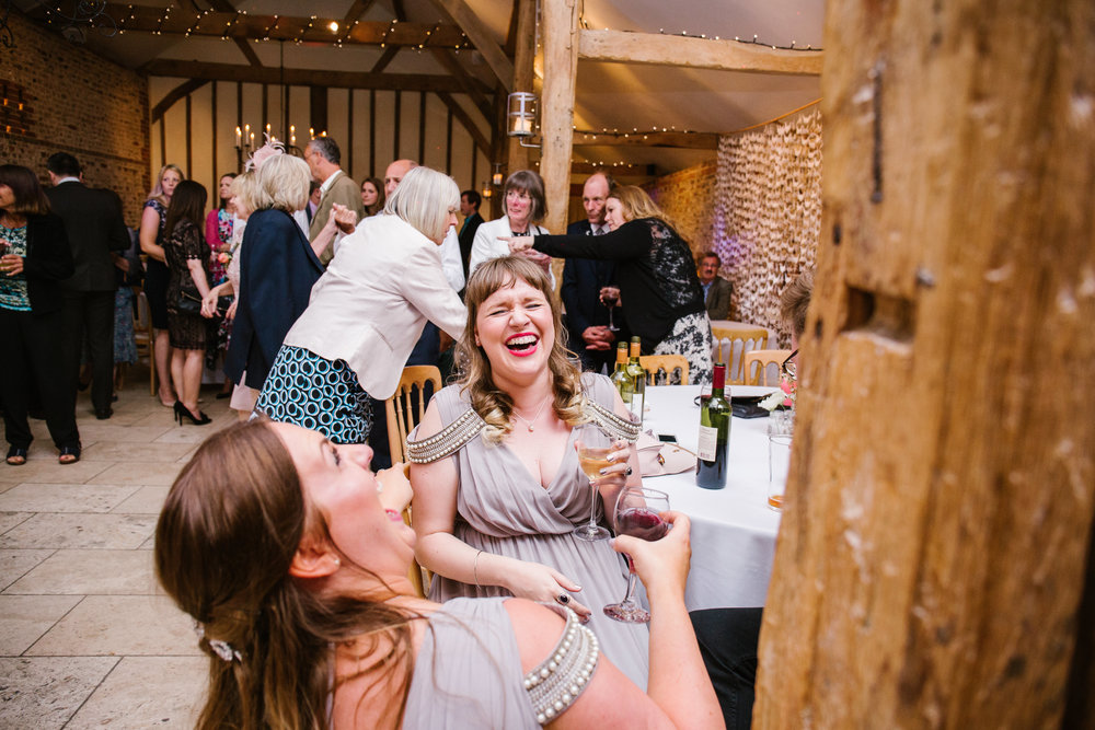 fun photo of bridesmaids laughing together at a diy wedding at upwaltham barns