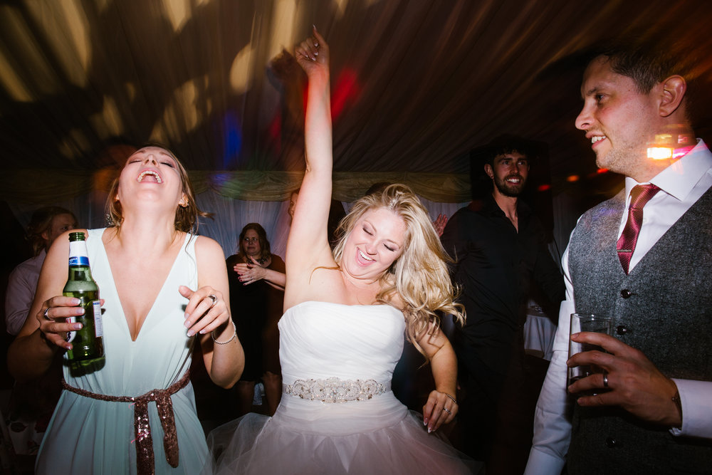 bride on the dance floor, dancing to the live band, having an epic time with her arms in the air- wedding photography in staffordshire
