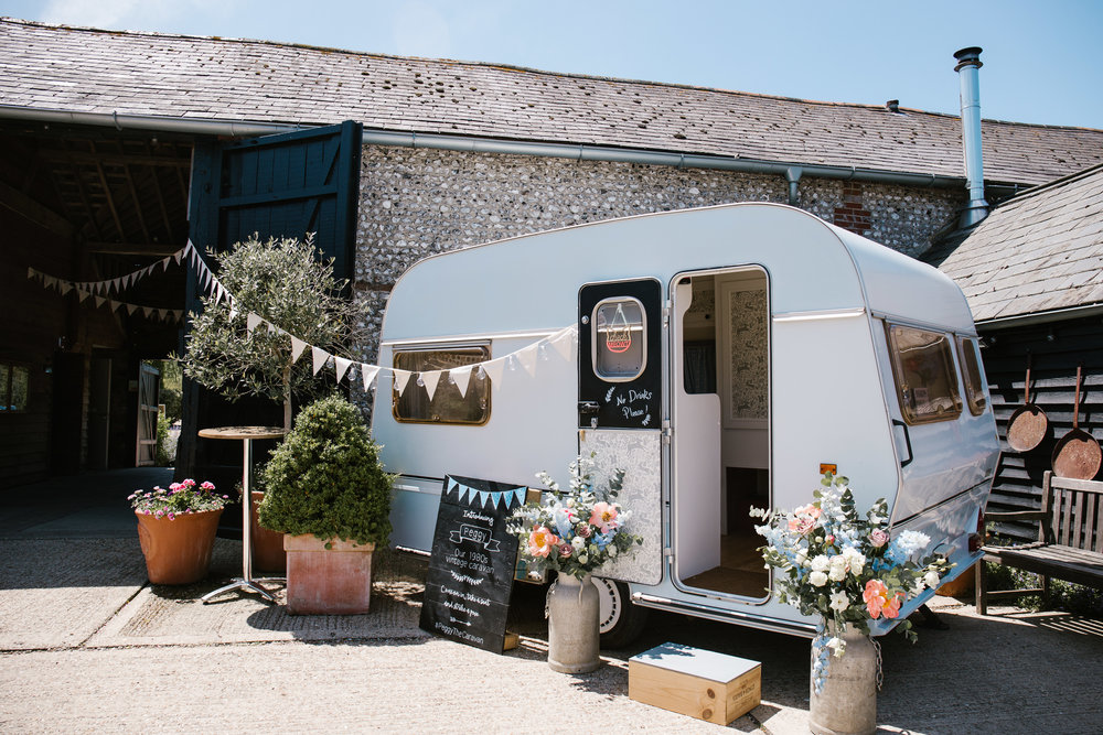 converted 1970s caravan which is being used as a photo booth at the diy wedding at upwaltham barns
