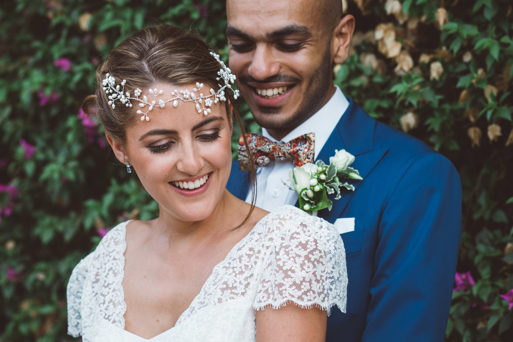 intimate photo of bride and groom as they smile together after their outdoor ceremony in marrakech morocco- destination wedding photography
