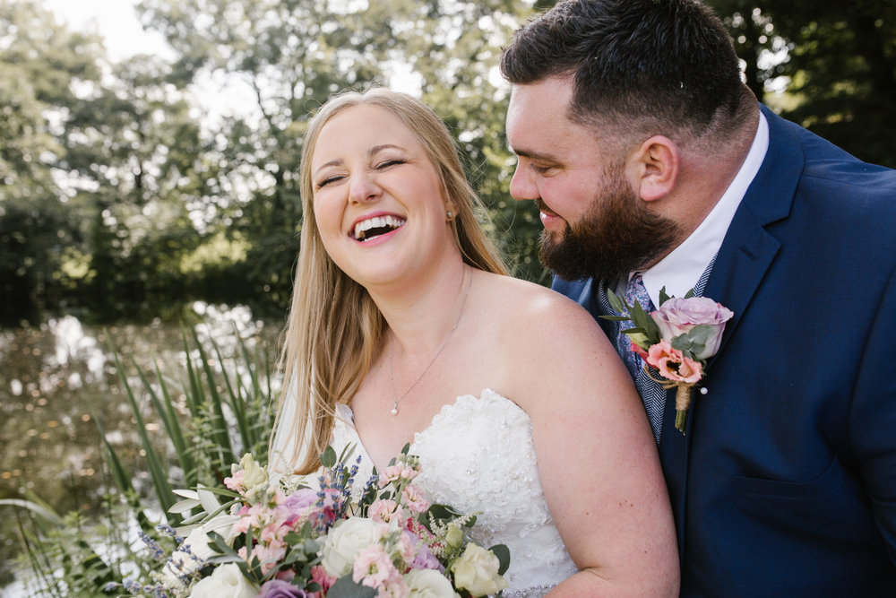 natural photo of bride and groom laughing at their summer wedding at the ashes barn in staffordshire- staffordshire wedding photographer