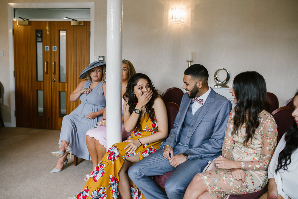 candid photo of wedding guests at intimate lichfield registry office wedding