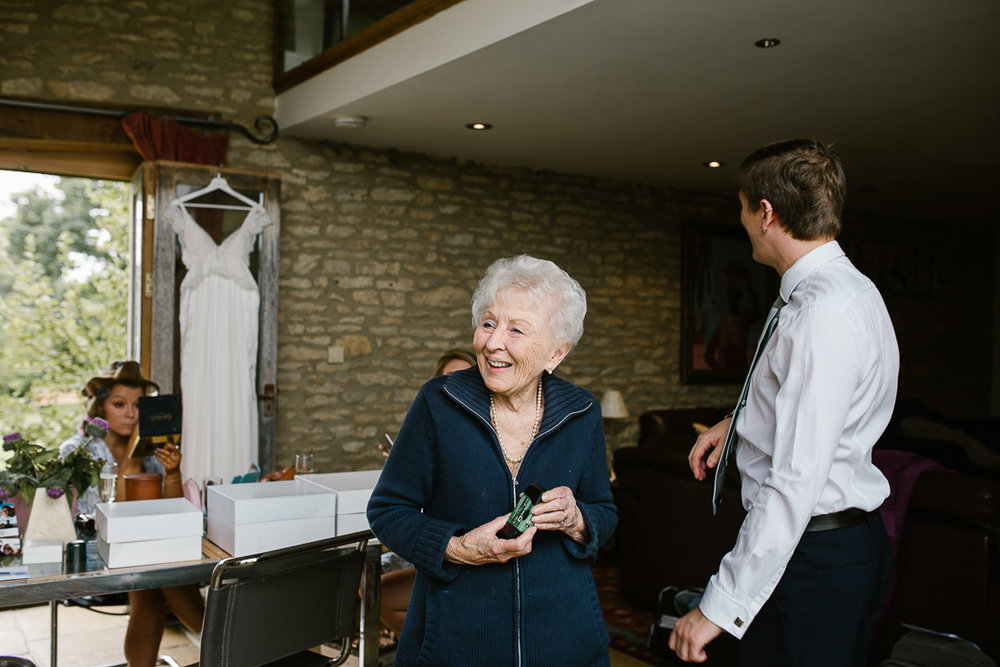 candid photo of nan smiling at her granddaughter on the morning of her wedding day