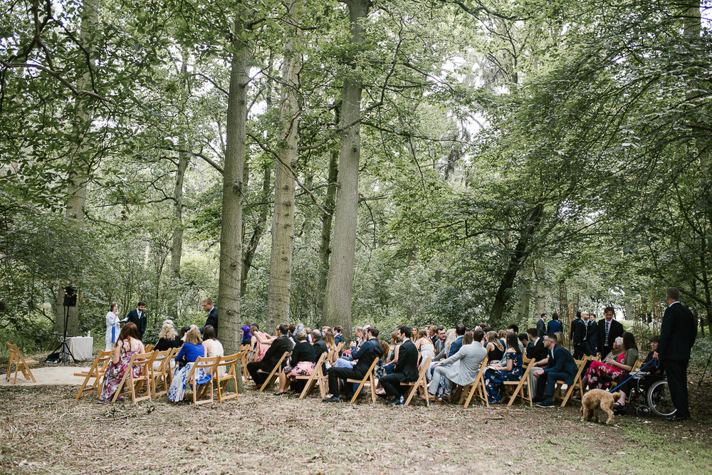 guests wait in the woodland area at Wildwood Bluebell for the outdoor ceremony to begin