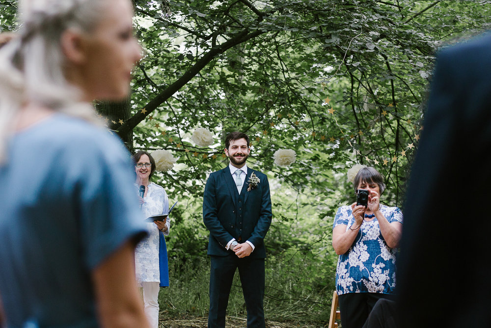 Emotional photo of a groom as he sees his beautiful bride for the first time